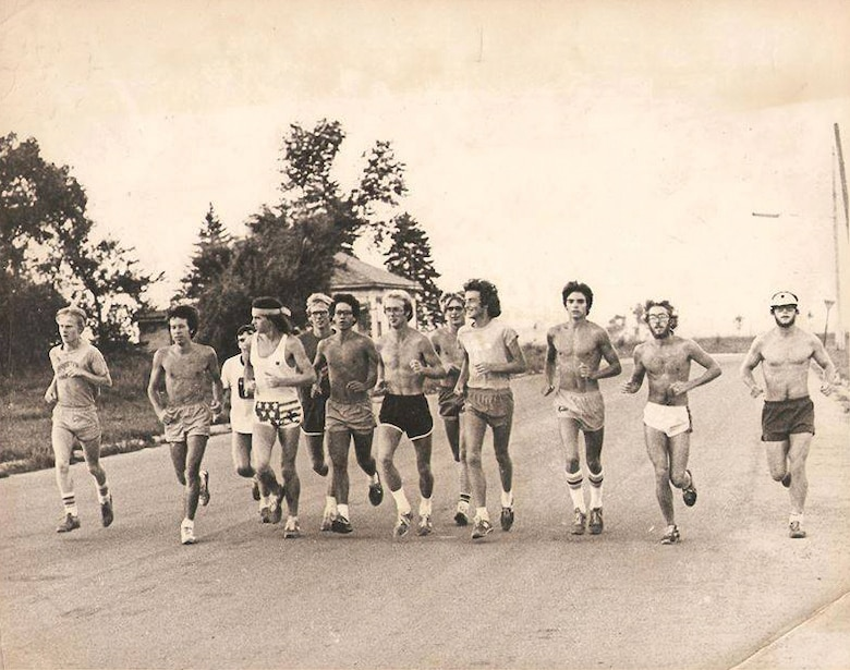 "In 1978, the South Dakota State University Cross Country Team won the NCAA Division II National title. Chamberlain, a 17-year-old freshman is at far left. Six of the runners in the photo, including Chamberlain, were NCAA Division II All-American. Two of the runners in the photo ran in the Olympic trials including fourth from the right, Dick Beardsley, who finished second in the Boston Marathon in 1982 with a time of 2:08:53. The story of Beardsley's second place finish to Alberto Salazar is known as the ""Duel in the Sun""."