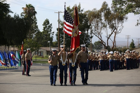 The national colors are posted during the relinquishment of command ceremony for the 1st Marine Division aboard Marine Corps Base Camp Pendleton, Calif., July 30, 2015. Major Gen. Lawrence D. Nicholson passed his role and responsibilities as the commanding general to Brig. Gen. Daniel D. Yoo.