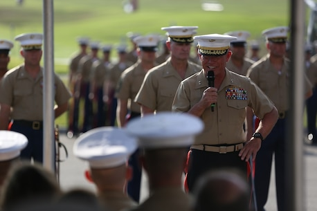 Major Gen. Lawrence D. Nicholson addresses the ceremony's guests  after relinquishing his role as the commanding general of the 1st Marine Division to Brig. Gen. Daniel D. Yoo aboard Marine Corps Base Camp Pendleton, Calif., July 30, 2015. Yoo most recently served as the assistant division commander for 1st Marine Division.