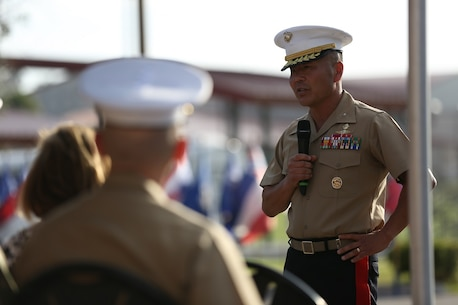 Brig. Gen. Daniel D. Yoo speaks to the guests after taking command of the 1st Marine Division from Maj. Gen. Lawrence D. Nicholson aboard Marine Corps Base Camp Pendleton, Calif., July 30, 2015. Yoo most recently served as the assistant division commander for 1st Marine Division.