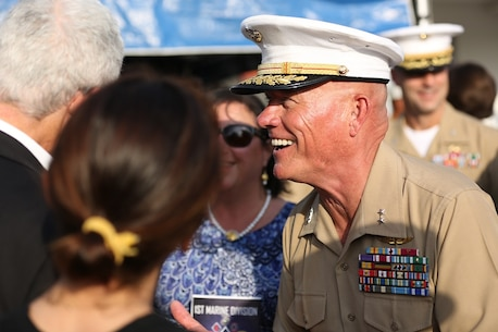 Major Gen. Lawrence D. Nicholson speaks with guests after relinquishing his role as the commanding general of the 1st Marine Division to Brig. Gen. Daniel D. Yoo aboard Marine Corps Base Camp Pendleton, Calif., July 30, 2015. Yoo most recently served as the assistant division commander for 1st Marine Division.