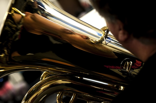 Eric T. Hansen, 17th Training Group security systems operations, practices his tuba during a band practice in the band hall at Angelo State University, San Angelo, Texas, July 28, 2015. The San Angelo Community plays two shows a year, one in August and one in late December. (U.S. Air Force photo by Senior Airman Scott Jackson/Released)