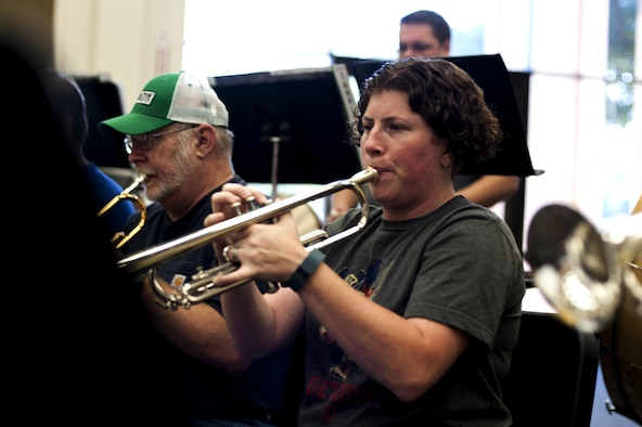 Kristin M. Ellis, Central High School assistant band director, practices her trumpet during band practice in the band hall at Angelo State University, San Angelo, Texas, July 28, 2015. The San Angelo Community band, founded 26 years ago, made up of various people from all backgrounds and ages, including military members retired and active. (U.S. Air Force photo by Senior Airman Scott Jackson/Released)