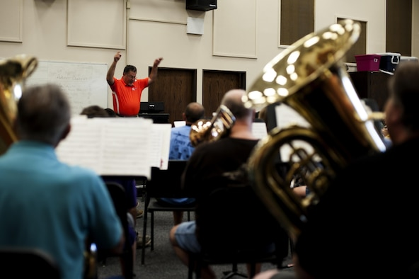 Dr. David Phillips, Central High School band director, conducts the San Angelo Community Band during band practice in the band hall at Angelo State University, San Angelo, Texas, July 28, 2015. The band meets to practice every Tuesday for weeks leading up to their events. (U.S. Air Force photo by Scott Jackson/Released)