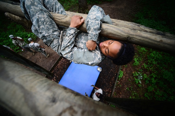 "U.S. Army Spc. Mykia Ward, a Multimedia Illustrator, assigned to the 55th Signal Company (Combat Camera), traverses the ""Weaver"" obstacle during the 2015 3rd Annual Spc. Hilda I. Clayton Best Combat Camera (COMCAM) Competition at the Maryland Army National Guard Gunpowder Military Reservation Training Site, Glen Arm, Md., July 15, 2015. The obstacle course is conducted on day three of the Spc. Hilda I. Clayton Best COMCAM Competition, which is designed to build self-confidence and teamwork by taking members out of their comfort zones.  The obstacle course is the sixth event, where teams of two compete throughout weeklong events that assess the technical and tactical skills of Visual Information Personnel. The competition is established in honor of the fallen Combat Camera Soldier, Spc. Hilda I. Clayton, who gave her life July 2, 2013, in Afghanistan as a part of Operation Enduring Freedom.  (U.S. Air Force photo by Staff Sgt. Sam Weaver/Released)"