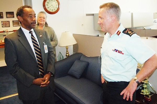 Dr. Jonathan Woodson, assistant secretary of defense for health affairs, left, meets with Canadian Forces Health Services commander and Surgeon General Army Brig. Gen. Hugh C. MacKay at the Pentagon, July 30, 2015. DoD photo by John Davis