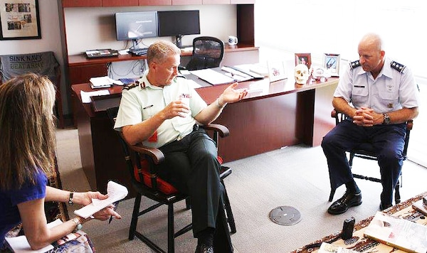 In a DoD News interview, Canadian Forces Health Services commander and Surgeon General Army Brig. Gen. Hugh C. MacKay, center, and Defense Health Agency Director Air Force Lt. Gen. Douglas J. Robb, right, share examples of U.S. and Canadian military medical cooperation at DHA in Falls Church, Va., July 30, 2015. DoD photo by Michael Sanchez
