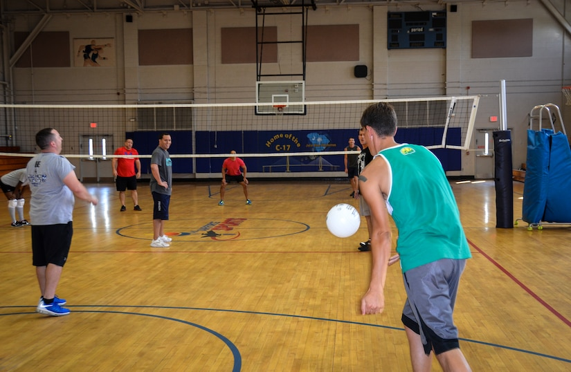 Nicholas Priest, 1st Combat Camera Squadron, serves during the Intramural Volleyball Season Opener against the 628th Security Forces Squadron, July 30, 2015 at Joint Base Charleston – Air Base, S.C. 628th SFS defeated 1st CTCS with scores of: 25-10, 22-25 and 15-5. The Volleyball season is expected to run until mid-September. (U.S. Air Force photo/Staff Sgt. AJ Hyatt)