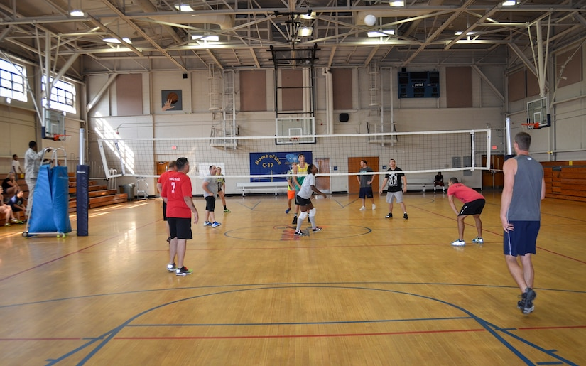 The 628th Security Forces Squadron team serves the ball during the Intramural Volleyball Season Opener against the 1st Combat Camera Squadron, July 30, 2015 at Joint Base Charleston – Air Base, S.C. 628th SFS defeated 1st CTCS with scores of: 25-10, 22-25 and 15-5. The Volleyball season is expected to run until mid-September. (U.S. Air Force photo/Staff Sgt. AJ Hyatt)