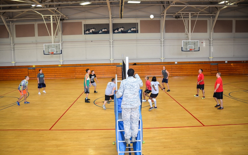 The 1st Combat Camera Squadron and the 628th Security Forces Squadron compete during the Intramural Volleyball Season Opener, July 30, 2015 at Joint Base Charleston – Air Base, S.C. 628th SFS defeated 1st CTCS with scores of: 25-10, 22-25 and 15-5. The Volleyball season is expected to run until mid-September. (U.S. Air Force photo/Staff Sgt. AJ Hyatt)