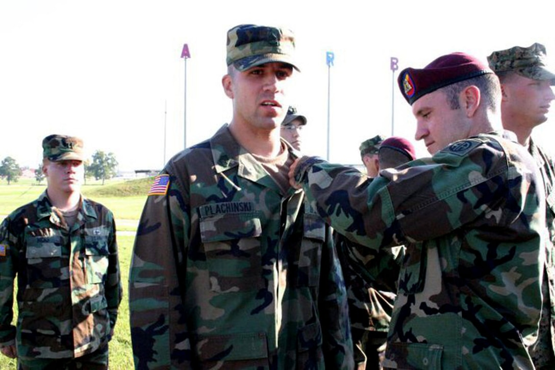 William Plachinski pins parachute wings on his brother, Michael, following an Airborne School  graduation ceremony at Fort Benning, GA, in September 2005. The brothers are now both first sergeants with United States Army Alaska. (courtesy photo)