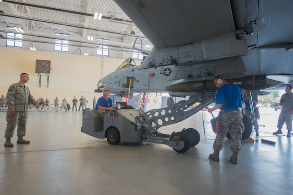 U.S. Air Force Tech. Sgt. Gregory Boggs, (left), 23d Maintenance Group loading standardization crew member, evaluates competitors from the 74th Aircraft Maintenance Unit during the load crew of the quarter competition July 17, 2015, at Moody Air Force Base, Ga. The weapons standardization section ensures all Airmen in the weapons community are certified and qualified to perform the mission. (U.S. Air Force photo by Airman 1st Class Ceaira Tinsley/Released)