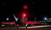 An EA-18G Growler taxis toward the end-of-runway in preparation to take off during Red Flag 15-3 at Nellis Air Force Base, Nev., July 28, 2015. Red Flag is an air-to-air, air-to-ground, and cyber combat training exercise conducted over the 2.9 million acre Nevada Test and Training Range north of Las Vegas. (U.S. Air Force photo by Airman 1st Class Mikaley Towle)