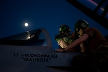 U.S. Navy sailors assigned to Electronic Attack Squadron 138, Naval Air Station Whidbey Island, Wash., perform pre-flight inspections on an EA-18G Growler during Red Flag 15-3 at Nellis Air Force Base, Nev., July 28, 2015. In addition to day-time operations, Red Flag conducts training exercises during the hours of darkness to train for low-visibility environments. (U.S. Air Force photo by Airman 1st Class Mikaley Towle)