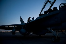 A U.S. Navy Airman assigned to Electronic Attack Squadron 138, Naval Air Station Whidbey Island, Wash., inspects an EA-18G Growler during Red Flag 15-3 at Nellis Air Force Base, Nev., July 28, 2015. Night missions have been integrated into Red Flag to prepare aircrews for missions in low-light environments. (U.S. Air Force photo by Airman 1st Class Mikaley Towle)