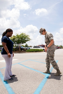 U.S. Air Force Airman 1st Class Jasmine Barnes (left), 23d Mission Support Group command section administrator, watches as Maj. (Dr.) Erin Sturgell, 23d Medical Operations Squadron clinical medicine flight commander, instructs her on proper foot placement when running during an appointment July 28, 2015, at Moody Air Force Base, Ga. Personnel from the clinical medicine flight offer patients a plan of action on their road to recovery for acute and chronic pain. (U.S. Air Force photo by Airman Greg Nash/Released)