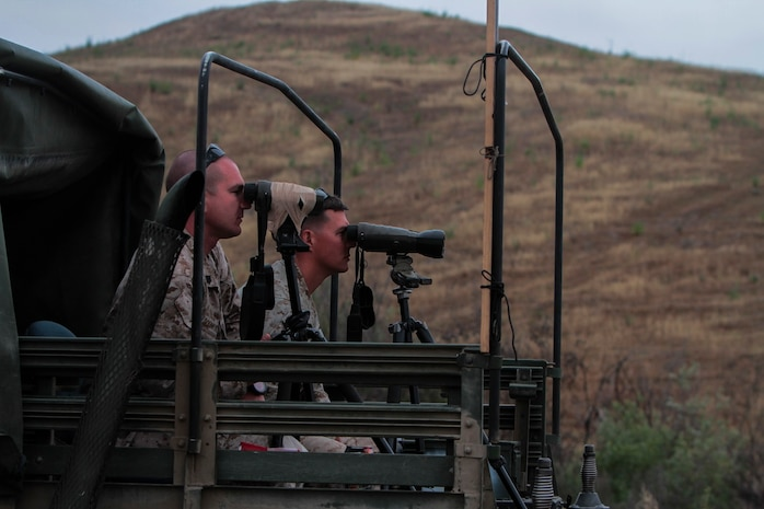 Instructors of Division School's Pre-Scout Sniper Course search for their students aboard Marine Corps Base, Camp Pendleton, Calif., May 27, 2015. The six students are well camouflaged as they practice stalking. (Photo by LCpl. Danielle Rodrigues/Released)