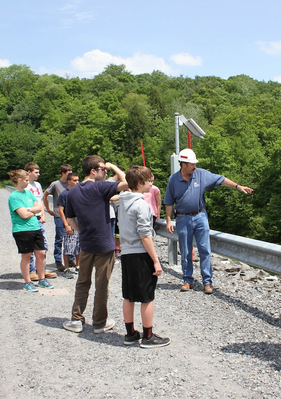 USACE Philadelphia District Dam & Levee Safety Program Manager Bruce Rogers conducts a tour with students from the Wallenpaupack High School Emergency Responders Club during a dam safety awareness event in May of 2015.