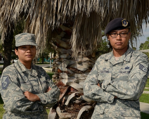 Master Sgt. Chasitity Gullatt, the 39th Air Base Wing Equal Opportunity superintendent, and her brother, Staff Sgt. Bryant Guillermo, a 39th Security Forces Squadron vault storage area supervisor, are stationed together at Incirlik Air Base, Turkey. This is the first time in their careers that they have been stationed together. (U.S. Air Force photo/Staff Sgt. Caleb Pierce)