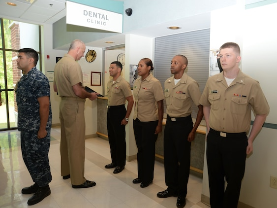 Lt. Cmdr. Raymond Bristol, officer-in-charge, Naval Branch Health Clinic Albany located at Marine Corps Logistics Base Albany, presents promotion commendations to sailors in a frocking ceremony, here, May 28. Sailors frocked for promotion were (left to right): HM2 Ricky Cuevas; HM3 Cholee Ward; HN Aundrea Maddox and HN Roderick Frederick. HM3 Nicholas Gilchrist and HN Benjamin Rozeboom, who are also promotion recipients, are scheduled to be frocked in a separate ceremony.