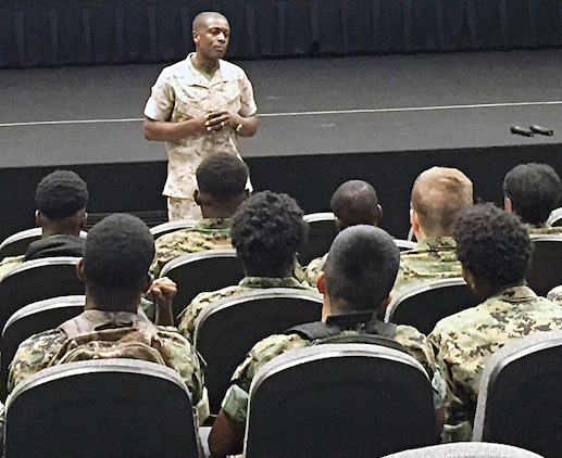 More than 30 members of the Dougherty Comprehensive High School, Albany, Georgia, Marine Corps Junior Reserve Officers' Training Corps listen to Lt. Col. James C. Carroll III, commanding officer, Marine Corps Logistics Base Albany, at a welcome aboard brief and motivational talk at the Base Theater during the first of a three-day Cadet Leadership Camp, June 1.