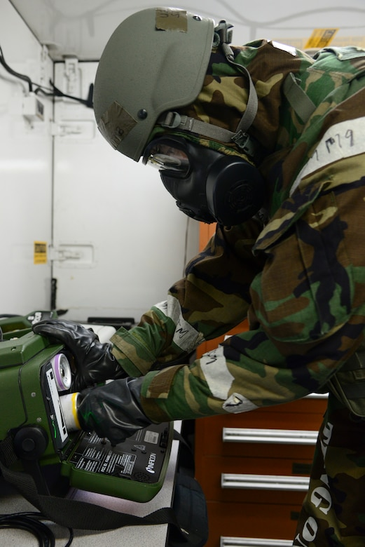 Staff Sgt. Steven Staab, 51st Aerospace Medicine Squadron NCO in charge of radiation, prepares a HAPSITE ER Chemical Identification System during Operational Readiness Exercise Beverly Midnight 15-1 March 4, 2015, at Osan Air Base, Republic of Korea. The HAPSITE ER is use to test the air for any chemical contamination. (U.S. Air Force photo by Senior Airman Matthew Lancaster)