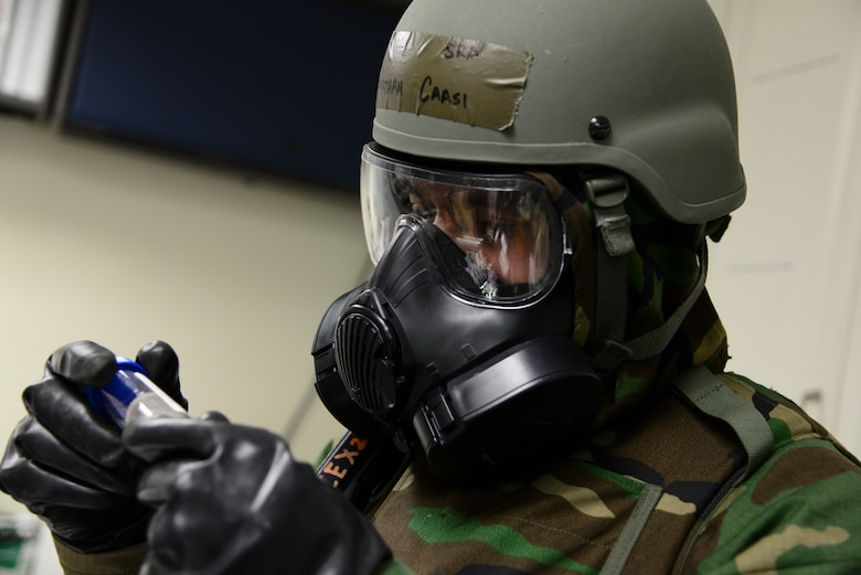 Senior Airman Jonathan Caasi, 51st Civil Engineer Squadron emergency manager, exams an air sample during Operational Readiness Exercise Beverly Midnight 15-1 March 4, 2015, at Osan Air Base, Republic of Korea. The sample is tested to determine if the air is containmined with biological agents. (U.S. Air Force photo by Senior Airman Matthew Lancaster)