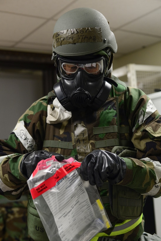 Staff Sgt. Steven Staab, 51st Aerospace Medicine Squadron NCO in charge of radiation, opens a bag with an air sample during Operational Readiness Exercise Beverly Midnight 15-1 March 4, 2015, at Osan Air Base, Republic of Korea. The sample is tested to determine if the air is containmined with biological agents. (U.S. Air Force photo by Senior Airman Matthew Lancaster)
