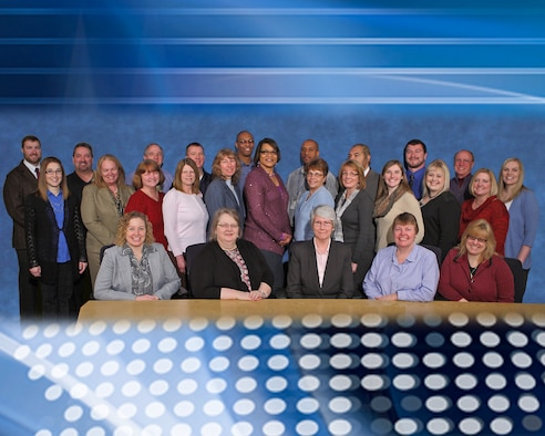 Pam Henson, pictured with the Financial Management team from AFRL Headquarters, says she will miss the people of AFRL the most, following her retirement June 2, 2015. (U.S. Air Force photo illustration by Jeremy Patton)