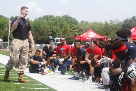 Sgt. Gary Ruiz, canvassing recruiter at Recruiting Substation Essex, motivates more than a hundred football players from the Greater New York and New Jersey areas during the Semper Fi All American Football Camp at Bridgewater-Raritan High School in Bridgewater, N.J., May 31, 2015.