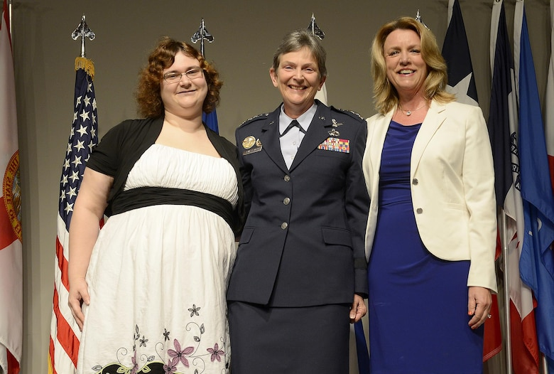 Secretary of the Air Force Deborah Lee James, right, congratulates newly promoted Gen. Ellen M. Pawlikowski and her daughter, Laura, during Pawlikowski's promotion ceremony June 1, 2015, at the Women's Memorial for Military Service in Arlington National Cemetery, Virginia. Pawlikowski is slated to become the commander of Air Force Materiel Command at Wright-Patterson Air Force Base, Ohio. (U.S. Air Force photo/Scott M. Ash)
