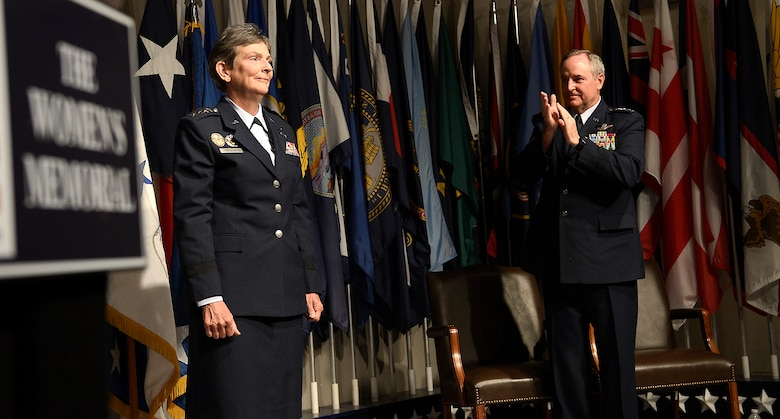 Air Force Chief of Staff Gen. Mark A. Welsh III congratulates newly promoted Gen. Ellen M. Pawlikowski during her promotion ceremony June 1, 2015, at the Women's Memorial for Military Service in Arlington National Cemetery, Virginia. Pawlikowski is slated to become the commander of Air Force Materiel Command at Wright-Patterson Air Force Base, Ohio. (U.S. Air Force photo/Scott M. Ash)