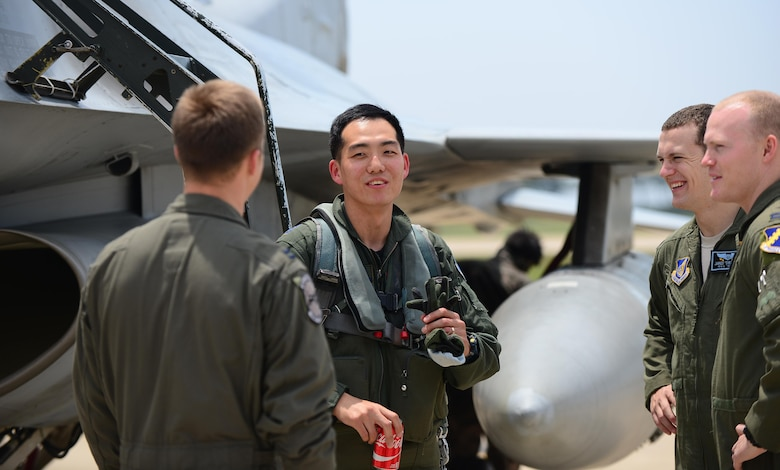South Korean air force Capt. Min-Gyu Han, a 123rd Tactical Fighter Squadron F-16 Fighting Falcon pilot, shares a laugh with fellow F-16 pilots from the 8th Fighter Wing after arriving to Kunsan Air Base, South Korea, for exercise Buddy Wing 15-4, June 1, 2015. During the five-day exercise, the 20th FW pilots, maintenance and support personnel are integrating with Kunsan AB Airmen on all aspects of the exercise to include mission planning, briefing, execution and debriefing. (U.S. Air Force photo/Staff Sgt. Nick Wilson)