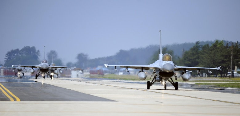 South Korean air force F-16 Fighting Falcons from the 123rd Tactical Fighter Squadron arrive at Kunsan Air Base, South Korea, for exercise Buddy Wing 15-4, June 1, 2015. Buddy Wing exercises are held multiple times throughout the year at various U.S. and South Korean air force bases to sharpen combined air combat tactics on the peninsula. (U.S. Air Force photo/Staff Sgt. Nick Wilson)