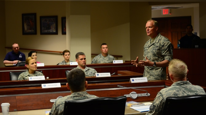Chief Master Sgt. of the Air Force James Cody speaks at Striker Stripe, a leadership development conference on Barksdale Air Force Base, La., May 27, 2015. Cody discussed issues about communication between Airmen and NCOs, trust and integrity. (U.S. Air Force photo/Airman 1st Class Luke Hill)