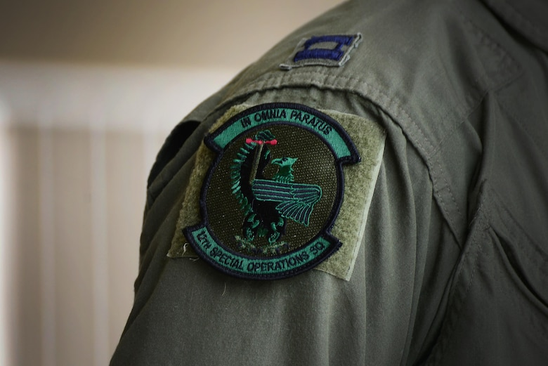 "The 12th Special Operations Squadron patch rests on the flight suit of members of the newly re-designated unit for the first time May 28, 2015 at Cannon Air Force Base, N.M. The patch reads ""In Omnia Paratus,"" a Latin phrase meaning ""ready for anything."" (U.S. Air Force Photo/Airman 1st Class Shelby Kay-Fantozzi)"