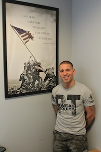 Bill Felmer poses for a photograph in his office at the Core Fitness Health Club, on May 5. Felmer recently became the first veteran to complete Western Connecticut State University's Honors Program while obtaining a bachelor's degree in political science. The 28-year-old Marine veteran is a Bethel, Connecticut native. (Official Marine Corps photo by Staff Sgt. Richard Blumenstein).