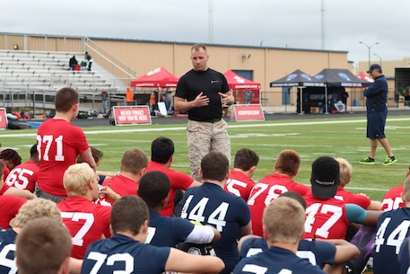 Staff Sgt Justin Hammer from Marine Corps Recruiting Station Indianapolis delivered a speech to players from across the region, during the RS Indianapolis Semper Fidelis All-American Football Camp at Decatur Central High School's May 31, 2015. The Semper Fidelis All-American Football Camp is the nation's premiere high school football camp series and bowl game presented by the United States Marine Corps.