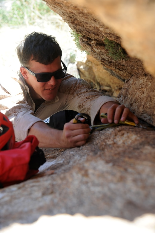 U.S. Marines Corps Cpl. James LaFrance, reconnaissance Marine, practices anchoring a rope using improvised rappel anchors during Angel Thunder 2015 high angle rescue training at Mount Lemmon, Ariz., June 1, 2015. During the training, U.S. Marines and U.S. Airmen practiced tying knots, anchoring ropes, rappelling down a cliffside unassisted, and returning to the initial elevation point.  Angel Thunder is an Air Combat Command-sponsored personnel recovery exercise for combat air force, joint, allied and interagency participants. LaFrance is assigned to Force Company, 1st Reconnaissance Battalion, 1st Marine Division at Camp Pendleton, Calif. (U.S. Air Force photo by Senior Airman Betty R. Chevalier/Released)