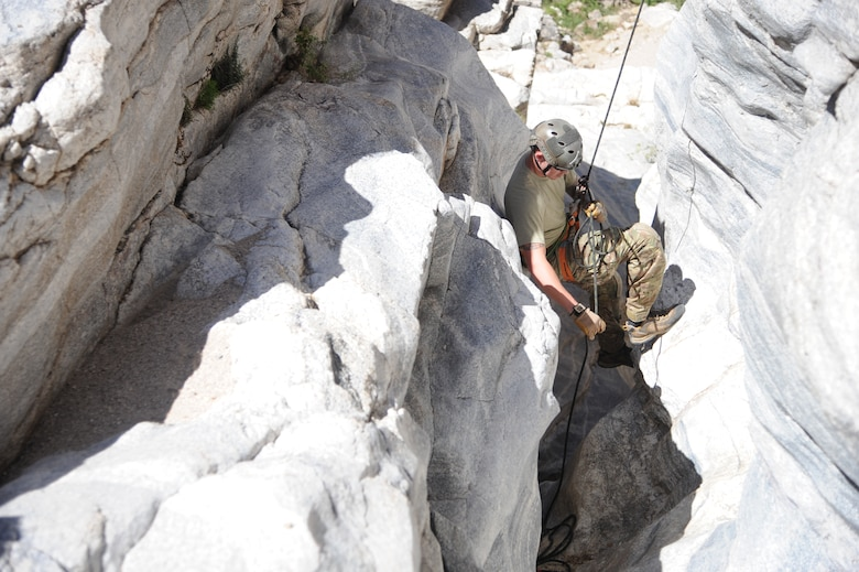U.S. Air Force Senior Airman Austin Sanders, reserve pararescueman, rappels down a cliffside during Angel Thunder 2015 high angle rescue training at Mount Lemmon, Ariz., June 1, 2015. During the training, U.S. Marines and U.S. Airmen practiced tying knots, anchoring ropes, rappelling down a cliffside unassisted, and returning to the initial elevation point. Angel Thunder is an Air Combat Command-sponsored personnel recovery exercise for combat air force, joint, allied and interagency participants. Sanders is assigned to the 304th Reserve Squadron at Portland Air National Guard Base, Ore. (U.S. Air Force photo by Senior Airman Betty R. Chevalier/Released)