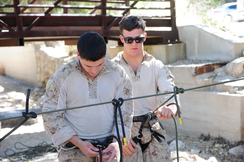 U.S. Marines Corps Cpls. Dave Peete and James LaFrance, reconnaissance Marines, practice tying and testing the strength of knots they will use to rappel during Angel Thunder 2015 high angle rescue training at Mount Lemmon, Ariz., June 1, 2015. During the training, U.S. Marines and U.S. Airmen practiced tying knots, anchoring ropes, rappelling down a cliffside unassisted, and returning to the initial elevation point. Angel Thunder is an Air Combat Command-sponsored personnel recovery exercise for combat air force, joint, allied and interagency participants. Peete and LaFrance is assigned to Force Company, 1st Reconnaissance Battalion, 1st Marine Division at Camp Pendleton, Calif. (U.S. Air Force photo by Senior Airman Betty R. Chevalier/Released)
