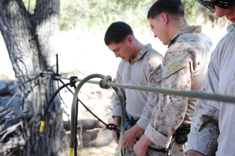 Knots sit on a line during Angel Thunder 2015 high angle rescue training at Mount Lemmon, Ariz., June 1, 2015. During the training, U.S. Marines and U.S. Airmen practiced tying knots, anchoring ropes, rappelling down a cliffside unassisted, and returning to the initial elevation point. Angel Thunder is an Air Combat Command-sponsored personnel recovery exercise for combat air force, joint, allied and interagency participants. (U.S. Air Force photo by Senior Airman Betty R. Chevalier/Released)