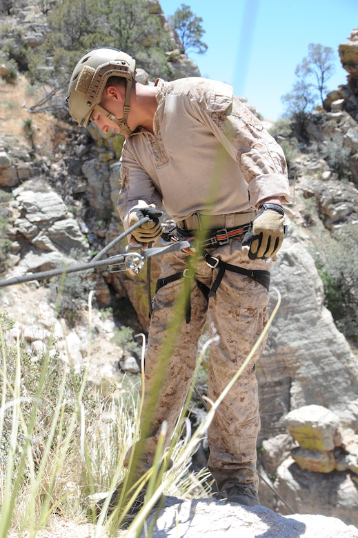 U.S. Marine Corporal Dan Peete, reconnaissance Marine, prepares to rappel down a cliffside during Angel Thunder 2015 high angle rescue training at Mount Lemmon, Ariz., June 1, 2015. Exercise Angel Thunder is the world's largest personnel recovery exercise, hosting 11 partner nations and nine inter-agencies at Davis-Monthan Air Force Base in Tucson, Ariz.  Peete is assigned to Force Company, 1st Reconnaissance Battalion, 1st Marine Division at Camp Pendleton, Calif. (U.S. Air Force photo by Tech. Sgt. Courtney Richardson)