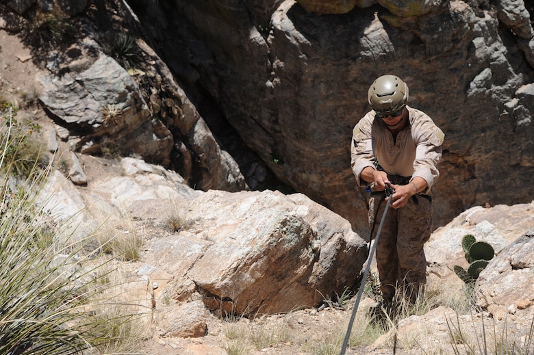 U.S. Marine Sgt. Preston Gabaldon, reconnaissance Marine, rappels down a cliffside during Angel Thunder 2015 high angle rescue training at Mount Lemmon, Ariz., June 1, 2015. During the training, U.S. Marines and U.S. Airmen practiced tying knots, anchoring ropes properly, rappelling down a cliffside unassisted, and returning to the initial elevation point. LaFrance is a assigned to Force Company, 1st Reconnaissance Battalion, 1st Marine Division at Camp Pendleton, Calif. (U.S. Air Force photo by Tech. Sgt. Courtney Richardson/Released)