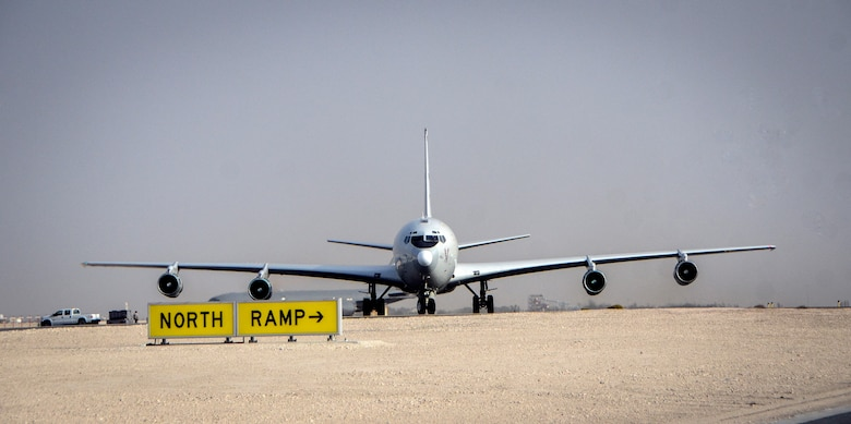 An E-8C Joint Surveillance Target Attack Radar System returns from a mission at Al Udeid Air Base, Qatar, May 1, 2014, after reaching a milestone of 100,000 flying hours to include more than 88,000 hours in the U.S. Central Command area of responsibility since 2001. The JSTARS mission is to provide ground commanders with intelligence, surveillance and reconnaissance air power to boost force protection, defensive operations, over-watch and combat search and rescue missions throughout the AOR. (U.S. Air Force photo/Senior Airman Jared Trimarchi/Released)