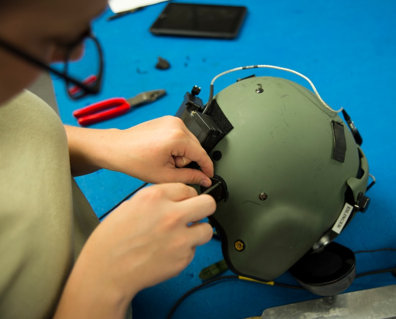 Airman 1st Class Lacey McGee, 811th Operations Support Squadron aircrew flight equipment technician, replaces parts on an HGU-56/P helmet on Joint Base Andrews, Md., May 26, 2015. Helmets undergo an inspection every 90 days to ensure they remain safe and operable. (U.S. Air Force photo/Airman 1st Class Ryan J. Sonnier)