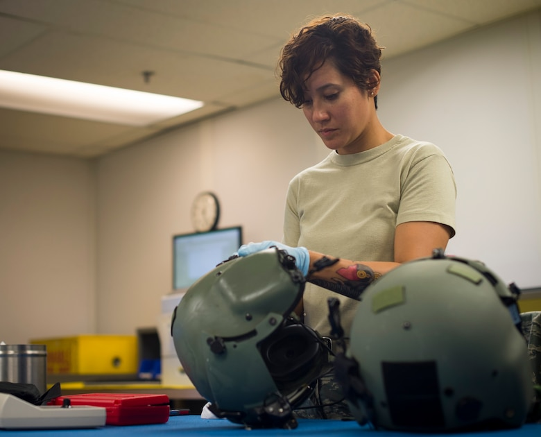Staff Sgt. Jennifer Francis, 811th Operations Support Squadron aircrew flight equipment technician, cleans an HGU-56/P helmet on Joint Base Andrews, Md., May 26, 2015. Helmets are inspected every 90-days to ensure they are safe and in good condition. (U.S. Air Force photo/Airman 1st Class Ryan J. Sonnier)