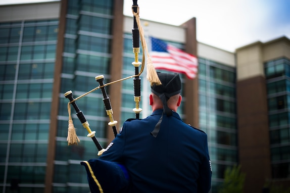 Tech. Sgt. Adam Tianello, U.S. Air Force Band bagpiper, performs during a wreath laying ceremony for National Police Week on Joint Base Andrews, Md., May 11, 2015. The ceremony honored security forces and military police who have paid the ultimate sacrifice in the line of duty. (U.S. Air Force photo by Staff Sgt. Chad C. Strohmeyer/released)