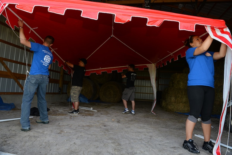 375th Operations Support Squadron Air Traffic Controllers assist with chores at Chakota, a therapeutic horseback riding center, Germantown, Illinois, May 28, 2015. One of the Airmen, Senior Airman Joshua Rose, has volunteered at Chakota before, bringing a group of Airmen with him to enhance the facility. This is one of the several instances where he rallies volunteer groups to make a bigger impact on community projects. (U.S. Air Force photo by Airman 1st Class Erica Crossen)