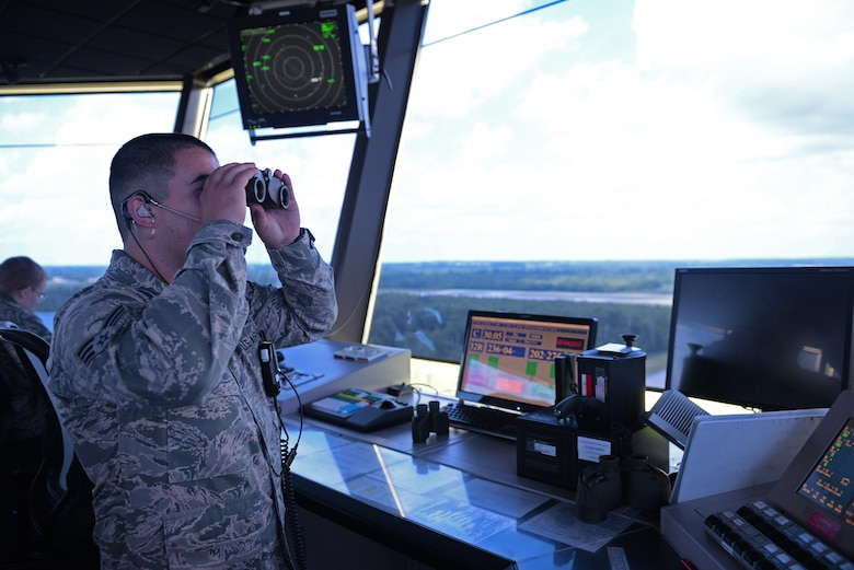 Senior Airman Joshua Rose, 375th Operations Support Squadron Air Traffic Controller, monitors flights within Scott Air Force Base, Illinois airspace, May 27, 2015. The Acushnet, Massachusetts native has been stationed at Scott for more than 2 years, and in his off duty time, he can found volunteering in the surrounding communities. (U.S. Air Force photo by Airman 1st Class Erica Crossen)